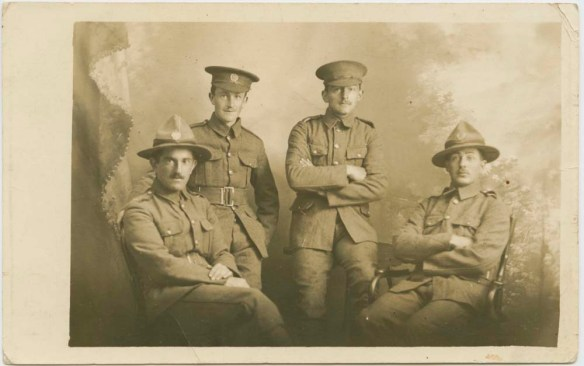 Photograph of Private Albert Cooper (front left), and three other unidentified soldiers take at Electric Studio, 90 Manners Street, Wellington, October 1914, prior to the departure of NZEF. collection of Hawke's Bay Museums Trust, Ruawharo Tā-ū-rangi,[75041]
