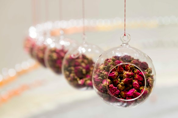 Rosebuds in hanging glass vessels, forming part of Indra's Bow